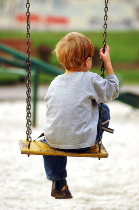 child relaxing on swing